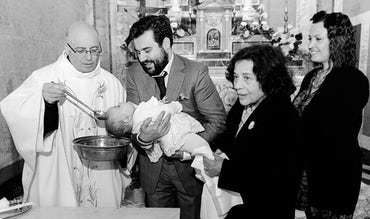 BABYBJÖRN Magazine – Devout Italian baptism in church.