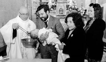 BABYBJÖRN Magazine – A spiritual Italian baptism in a church.