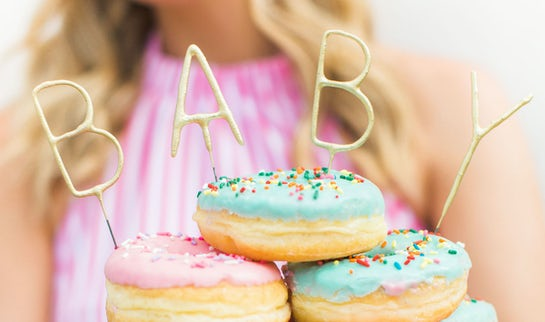 BABYBJÖRN Magazine – Colorfully decorated donuts are perfect as baby shower decorations.