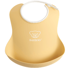Comfy, waterproof baby bib with deep spill pocket catches any mess, Powder yellow - BABYBJÖRN