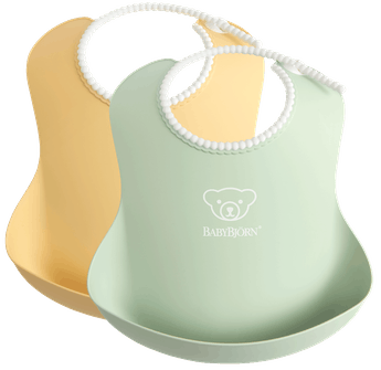 Baby Bib, 2-pack, Powder yellow / Powder green, with deep spill pocket to catch any mess - BABYBJÖRN