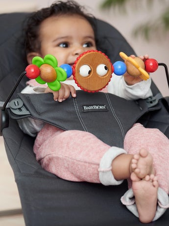 Toy for Baby Bouncer in wood and BPA-free plastic, Googly Eyes - BABYBJÖRN