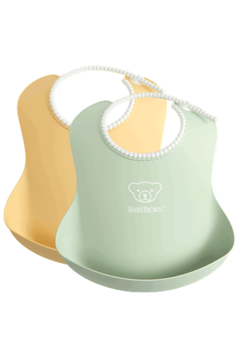 Baby Bib, 2-pack, Powder yellow/ Powder green, with deep spill pocket to catch any mess - BABYBJÖRN