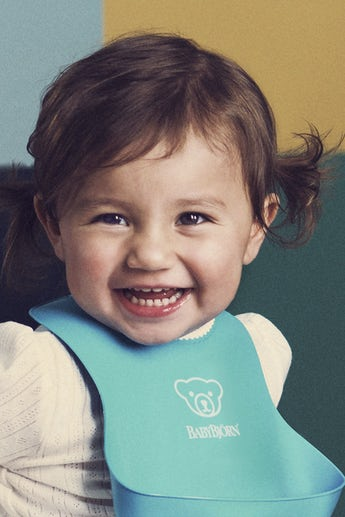 Baby Bib, Turquoise, with deep spill pocket to catch any mess - BABYBJÖRN