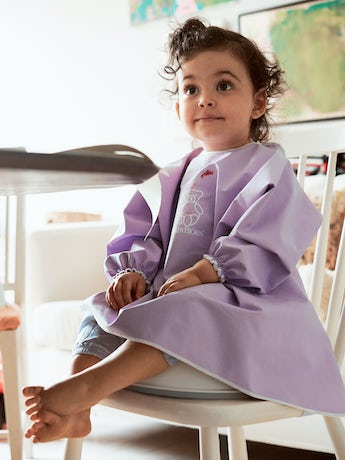 BABYBJÖRN Long Sleeve Bib in purple BPA-free plastic, bib and apron in one, covers both front and back.