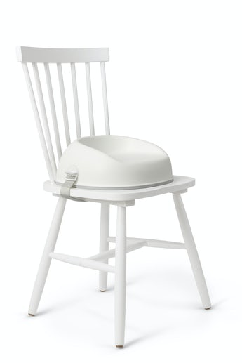 BABYBJÖRN Booster Seat in white, a smart solution that you place on a chair to help your child reach the table.