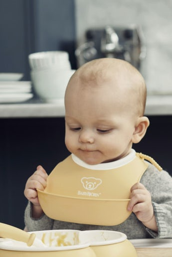 Small Baby Bib in 2-pack Powder Yellow and Powder Green - BABYBJÖRN